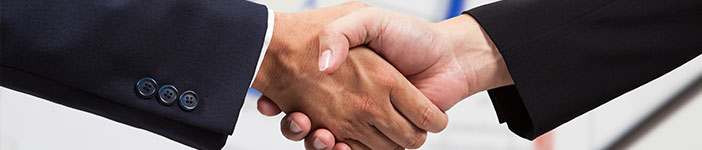Photo of two businessmen shaking hands
